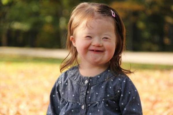 Photographer captures heartwarming portraits of young children with Down syndrome to celebrate the 'inspiring, funny, and happy' kids affected by the condition Rhode Island-based photographer Laura Kilgus has been passionate about helping the Down syndrome community Credit: Laura Kilgus link back: http://www.9tenphoto.com/